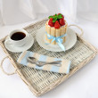 Dessert souffle with biscuit and fresh strawberries and a cup of - Stock Photo