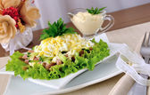Salad with ham, cucumber, egg under the chips — Stock Photo