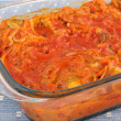 Stock Photo: Baked fish in tomato sauce with vegetables