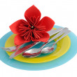 A set of cutlery on a plate with a flower made of paper na — Stock Photo #9866671