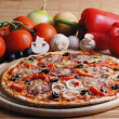 Pizza with tomatoes — Stock Photo #10474537