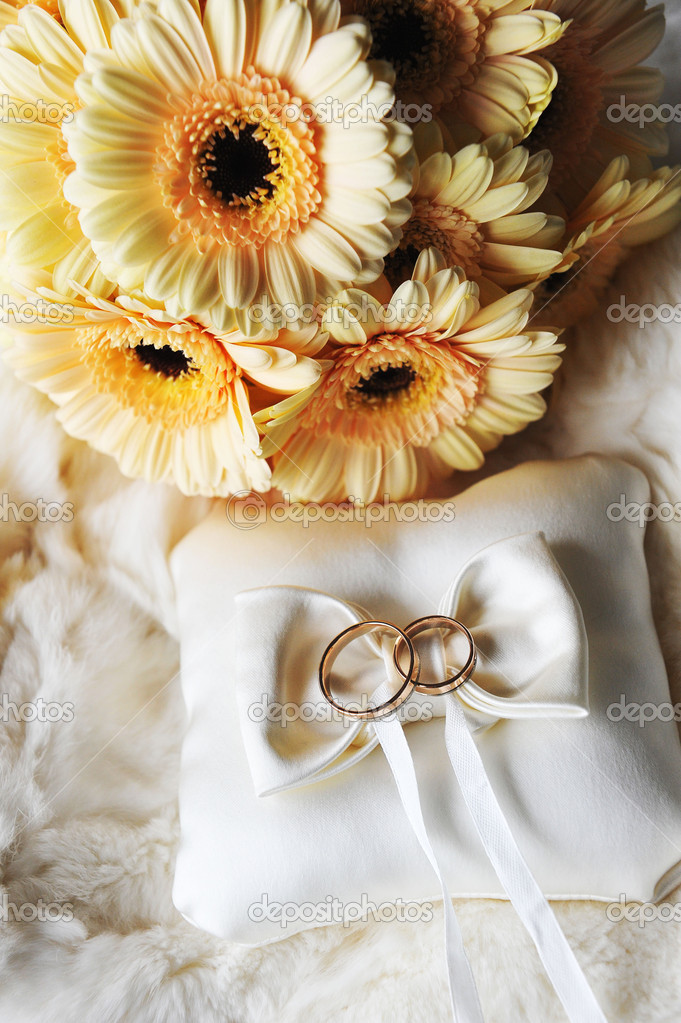 Bride bouquet of yellow flowers and cushion with wedding  gold rings  Stock Photo #10474424