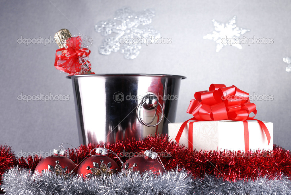 Bucket with champagne bottle  and garland. christmas symbols — Lizenzfreies Foto #10474522