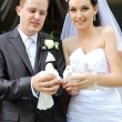 Newlyweds with doves — Stock Photo #8981131