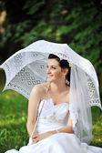 Bride with umbrella — Stock Photo