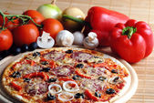 Pizza with tomatoes — Stock Photo