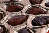 Chocolates in foil box — Stock Photo