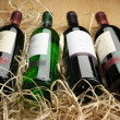 Foto de Stock  : Wine bottles in straw