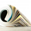 Stock Photo: Rolled magazine