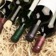 Wine bottles in straw — Stock Photo #8524088