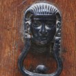 Metal knocker, pharaoh-shaped — Stock Photo
