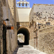 Traditional alley front of church at Santorini island in Greece — Stock Photo #10106654