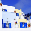 Old Greek  traditional house with blue window in Santorini island, Greece - Stock Photo