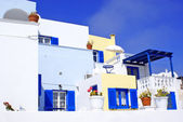 Old Greek traditional house with blue window in Santorini island, Greece — Stock Photo