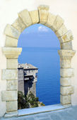 Traditional greek castle through an old window, Greece — Stock Photo