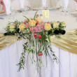 Bouquet on the wedding table — Stock Photo