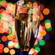 Champagne glass on festive background — Stock Photo