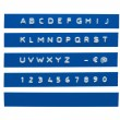 Embossed alphabet on blue plastic tape — Stock Photo