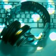 Dj headphones on laptop - Stock Photo