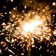Stock Photo: Yellow sparkler with fire particles