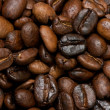 Fried coffee beans background — Stock Photo