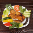 Roast chicken in plate — Stock Photo