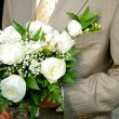 Stock Photo: Bridegroom holding bouquet of roses