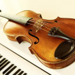Royalty-Free Stock Photo: Violin and piano keys