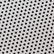 Stock Photo: Perforated metallic background