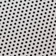 Perforated metallic background — Stock Photo