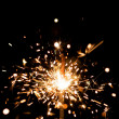 Yellow sparkler with fire particles — Stock Photo #10232604