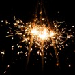Yellow sparkler with fire particles — Stock Photo #10232890