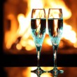Royalty-Free Stock Photo: Blue glasses in front of fireplace