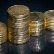 Columns of golden coins — Stock Photo
