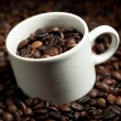Cup with coffee beans — Stock Photo #10234252