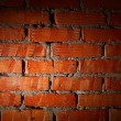 Aged brick wall illuminated with spotlight — ストック写真