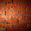 Aged brick wall illuminated with spotlight -  