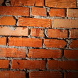 Aged brick wall illuminated with spotlight — Stock Photo