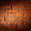 Aged brick wall illuminated with spotlight - 图库照片