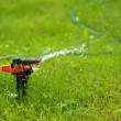 Closeup of lawn sprinkler with copyspace — Stock Photo #10234921