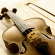 Antique violin with fiddlestick — Stock Photo