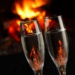 Glasses with alcohol in front of fireplace, closeup — Stock Photo