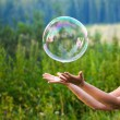 Hand catching a soap bubble — Stock Photo #10236018
