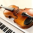 Violin and piano keys - Stock Photo