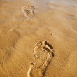 Stock Photo: Footprints on the sand