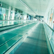 Stock Photo: Airport interior with moving stairway, picture taken at Munich Airport