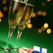 Stock Photo: Champagne glasses and gifts