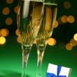 Champagne glasses and gift — Stock Photo #10237874