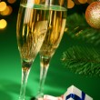 Festive champagne glasses with gifts — Stock Photo