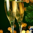 Champagne glasses and gift — Stock Photo